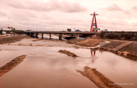 Rare view of water in the Santa Ana River running past the Anaheim Stadium