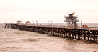 South side of San Clemente Pier and big surf from the storm.