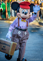Mickey can be seen in costume, all over the park.  Here a passenger on the Red Trolley.