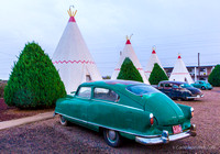 Wigwam Motel has not-so-classic cars in front of each unit.