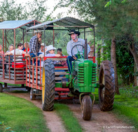 Their press release:  A classic John Deere tractor pulls riders in wagons around the Ranch, past vintage farm equipment, farm critters and far into the depths of the Old West where graves are shallow