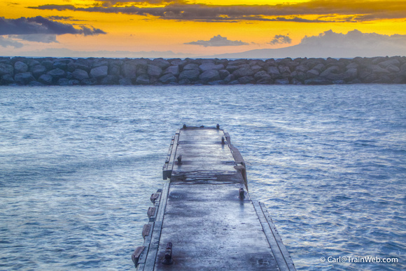 Kihei boat dock and sea wall at sunset