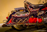 The docent pointed out Indian-inspired trappings on the motorcycle.